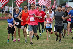 JIM BESEDA/MOLALLA PIONEER - A field of 412 runners heads out from Heckard Field at the start of Monday's fifth annual Freedom 5K road race.