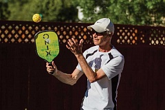 PAMPLIN MEDIA GROUP: CHASE ALLGOOD - Steve Paranto warms up before a game of pickleball with friends at his Hillsboro home.