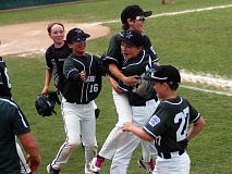 DAN BROOD - Tigard Little League Majors center fielder Griffin Mentzer (second from right) celebrates with his teammates after throwing out a pair of Lake Oswego base runners during Monday's District 4 tournament game.