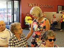 JASON CHANEY/CENTRAL OREGONIAN - Pam Reinhart visits with longtime Wells Fargo customer Arlene Deitz during Reinhart's retirement party on July 2. She worked at the bank for 41 years, most recently as a personal banker.
