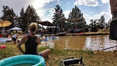 PHOTO COURTESY OF JACOB CRAWFORD - A photo taken during a prior Crawfest event. Held on Jacob Crawford's Powell Butte-area ranch, people are invited to tent camp, swim and enjoy games as bands play on two stages.