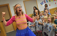SPOKESMAN PHOTO: VERN UYETAKE - Heather Pearl of Mz. Pearls Variety Show leads a clowning activity at the Wilsonville Public Library July 7.