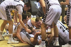 SPOKESMAN FILE PHOTO: COREY BUCHANAN - Wilsonville boys basketball players celebrate after they win the 5A state title.