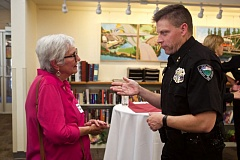TIMES PHOTO: JAIME VALDEZ - Jeneane Dunmyer meets new Tualatin Police Chief Bill Steele during a public meet-and-greet at the Juanita Pohl Center.