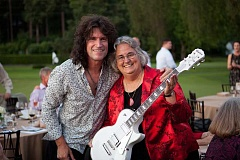 COURTESY PHOTO - Pacific University president Lesley Hallick, right, with KISS guitarist and university trustee Tommy Thayer, host of the schools Legends fundraiser since 2007. Thayer was honored for his service to the university at the final Legends event June 26 in Portland.
