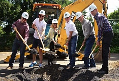 REVIEW PHOTO: VERN UYETAKE - City Councilors Jon Gustafson (from left), Joe Buck, Jackie Manz and Skip ONeill join Mayor Kent Studebaker and Councilor Jeff Gudman in turning the inaugural shovelfuls of dirt for the new Operations and Maintenance Center.