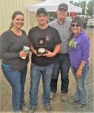 PHOTO COURTESY OF BLAIN WHEELER - Scappoose High junior Blain Wheeler won steer daubing at the Pacific Northwest Invitational Championship in a two-run time of 3.08 seconds June 18-20 in Moses Lake, Wash. From left are Wheeler's mother Shena, Blain, his brother, Colten, and grandmother Karen Stanley.