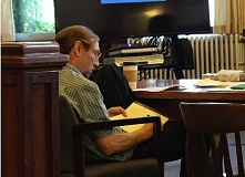 JASON CHANEY - Curtis Hooper, at his trial early Tuesday, July 5, writes messages on a notepad for his defense attorney, Valerie Wright, to relay to Judge Daniel Ahern.