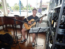 BARBARA SHERMAN - Keaton Woodburn entertains patrons at 503 Uncorked in Old Town Sherwood on July 13. where he has been warmly received.