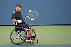 COURTESY PHOTO: USTA/PETE STAPLES - Playing in the U.S. Open in Flushing, N.Y., in September 2015, former Hillsboro resident David Wagner, a wheel chair tennis champ, returns a volley in the Billie Jean King National Tennis Center.