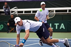TRIBUNE PHOTO: JAIME VALDEZ - The Bryan brothers struggle to return a shot in their Davis Cup doubles match Saturday at Tualatin Hills Tennis Center.