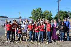 JASON CHANEY/CENTRAL OREGONIAN - Clinic Pharmacy staff, including owner Sean Phothiyane (in white jacket), join local leaders and guests in a groundbreaking ceremony for the new pharmacy and accompanying development Wednesday morning.