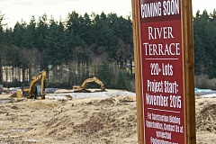 TIMES FILE PHOTO - Tigard is on track to blow past the 50,000-resident mark up to a population of close to 70,000. The cities are respectively second and third only to Portland in projected raw growth, according to Metro's numbers. River Terrace, at the corner of Scholls Ferry and Roy Rogers roads, will see much of that growth