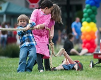 OUTLOOK PHOTO: JOSH KULLA - Children partake in a heated match of tug-of-war during the art festival at the family fun zone.