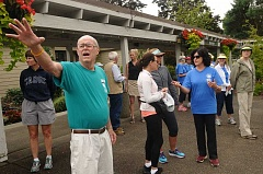 SPOKESMAN PHOTO: VERN UYETAKE - Dick Spence of Wilsonville Community Sharing gives instructions to walkers.