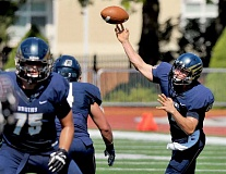 SETH GORDON - Grant Schroeder, who finished fourth in the Northwest Conference with 2,241 passing yards as a sophomore and is an engineering major with a 3.72 grade-point average, was named to the NWC Scholar-Athlete first team along with Bruin track standout Dakota Buhler.