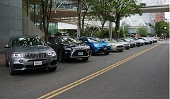 PORTLAND TRIBUNE: JEFF ZURSCHMEIDE - Green cars were tested at Drive Revolution at the World Trade Center in Portland on July 19.