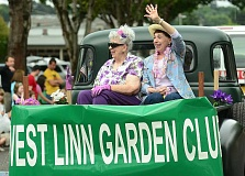 Judith Hutchinson, left, and Marilyn Ellwood of the West Linn Garden Club wave to the parade crowd.