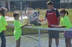 HERALD PHOTO: COREY BUCHANAN - Canby youth tennis players play a game of smash-net during the Canby youth tennis camp on Wednesday, July 13.