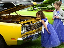 TIDINGS PHOTO: VERN UYETAKE - Old Time Fair Junior Court Princesses Jillian Pyle, right, and Biance Molden check out the action at the Saturday car show July 16.