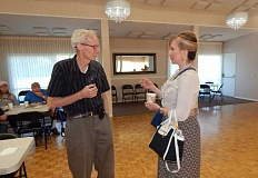 BARBARA SHERMAN - Before the start of the July 13 meeting of the Southwest Corridor Republican Club, Gary Hughes (left) of Tigard chats with state Sen. Kim Thatcher (R-Keizer) in the King City Clubhouse.