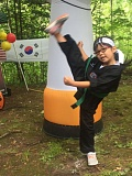 OUTLOOK PHOTO - Zoey, 7, shows off the high kick she learned at World Champion Tae Kwondo.