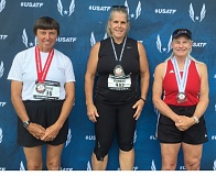 SUBMITTED - Milwaukies Monica Kendall (center) proved herself one of the top 60-year-old female athletes in the nation earlier this month, placing first in her age division in the shot put and discus and second in the javelin at the USATF Masters Outdoor Track and Field Championships in Grand Rapids, Michigan.