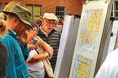 PHOTO BY DAVID F. ASHTON  - Before the annual Independence Day parade started, some neighbors stopped to look at maps and exhibits put up by the Eastmoreland Historical District proponents.