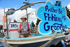 CONNECTION PHOTO: VERN UYETAKE - Greg Boyce rides in last year's Corbett Fish House entry.