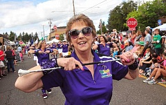 CONNECTION PHOTO: VERN UYETAKE - Patti Waitman-Ingebretsen shows her baton skills in last year's parade.