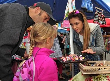 CONNECTION PHOTO: VERN UYETAKE - Tatiana Dyler was one of the vendors selling her jewelry at last year's street fair.