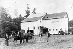 SCOTTS MILLS AREA HISTORICAL SOCIETY - Scotts Flour Mill on Butte Creek about 1900. Thomas Scott is sitting in the buggy at left. The tricycle steam tractor next to the building was built in Woodburn by the Remington Co. that is run by the same family today making firearems.