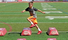 SPOKESMAN PHOTO: VERN UYETAKE - Callen Wilson, 10, of West Linn works on his agility Thursday, July 21, during the tackling camp.