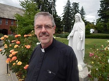 STAFF PHOTO: CLIFF NEWELL - Father Gregg Bronsema is happy that Our Lady of the Lake Catholic Parish is located right in the heart of Lake Oswego.