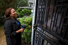 TRIBUNE FILE PHOTO - Loretta Smith shown knocking on doors during her successful 2010 campaign for Multnomah County comissioner. The county is now garnishing her wages for a $37,000 tax debt.
