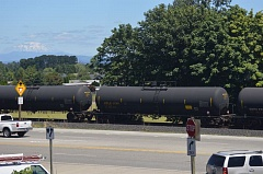 SPOTLIGHT FILE PHOTO - A unit train carrying tanker cars marked for ethanol travels through the county earlier this summer. Port of St. Helens commissioners say they want ethanol shipments by rail to be done with only the newest model of tanker car, for safety.