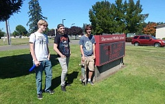 PMG PHOTO: BARBARA SHERMAN - Hanging out in front of Sherwood Middle School, which would become home to J. Clyde Hopkins Elementary  School students if the bond measure passes, are (from left) Ben, who graduated from Sherwood High School in 2016; Josh, who will be a senior; and Gavin, who will be a junior.