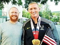 SUBMITTED PHOTO - Newberg's David Hostetler celebrates brother Cyrus Hostetler's win in the javelin at the U.S. Olympic Trials in Eugene last month.