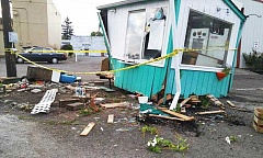 SUBMITTED PHOTO - An overnight hit-and-run left the Speedy Espresso drive-thru coffee stand virtually destroyed Sunday. Police are searching for a large flat-bed pickup truck in connection with the crash.