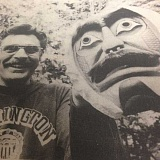 FILE PHOTO - Robert Peasley stands with one of the Indian tribal masks he carved. Peasley received national recognition as a carver of the masks in 1976.