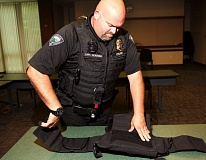 TIMES PHOTO: JAIME VALDEZ - Tualatin Police Capt. Greg Pickering shows what a tactical vest is made of at the police station.