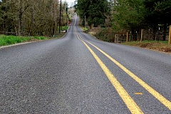 SPOKESMAN FILE PHOTO - Clackamas Countys 1,400 miles of road have a multi-million dollar backlog of maintenance work, which the proposed gas tax revenues are hoped to alleviate.