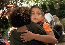 REVIEW FILE PHOTO: VERN UYETAKE - First-grader Kiahn Cutlip gets a big hug from his mom after his first day of school at Lake Grove Elementary in 2015.