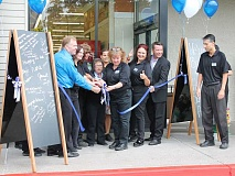 REVIEW PHOTO: ANTHONY MACUK - Store Director Greg Bowen leads employees in a ribbon-cutting ceremony on Aug. 3 to celebrate the return of Albertsons to its Lake Grove location.