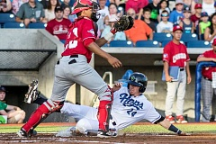 HILLSBORO TRIBUNE PHOTO: CHASE ALLGOOD - Hops short stop Mark Karaviotis slides into home to score during the Hops' 6-3 win over the Vancouver Canadians Friday night, Aug. 12.