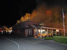 SUBMITTED PHOTO - Smoke billows from the roof of Miller's Homestead restaurant in Tualatin on Sunday night. The popular eatery's owners say they hope to reopen as soon as possible.