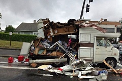 COURTESY PHOTO - The Ginsbah family's motorhome was destroyed after the Multnomah County Sheriff's Office spokesman said the driver of a semi truck was unable to stop as he sped down hilly, wet pavement approaching Southwest 257th Avenue and Halsey Street, causing the back of his truck to weave and tear through the rear side of the motor home as he slid through the intersection.