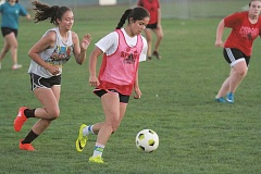 PHIL HAWKINS - North Marion sophomores Emma Holum (left) and Mar Verastegui play opposite of each other at the Huskies fall conditioning session last week. Verastegui earned Second Team all-conference honors, leading the girls soccer team in scoring last year, and is poised for a comeback season after breaking her clavicle in the final game of the 2015 campaign.