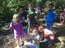 SUBMITTED PHOTO - CREST campers showoff their newly caught crawdads during last weeks EnviroCamp.