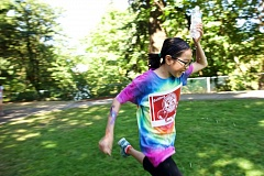 TIMES PHOTO: JAIME VALDEZ - Team Gallifrey's Yun Yi, 11, runs with a bottle of water on her head during a water race on the last day of teen summer reading club for the Tualatin Public Library.